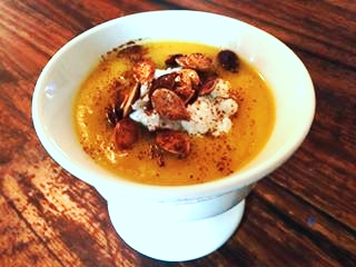 Pumpkin Soup topped with feta cheese, roasted pumpkin seeds and a sprinkle of chili powder.