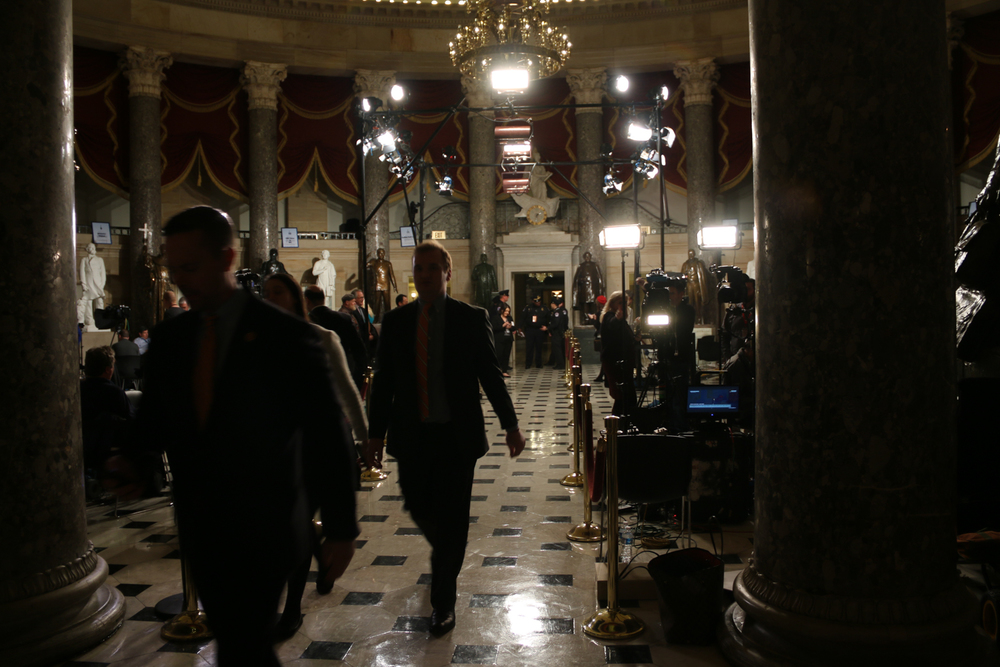 Camera crews set up their equipment in Statuary Hall outside the House Chamber in the hours preceding the speech. Senators and representatives later entered the chamber through the roped-off aisle.