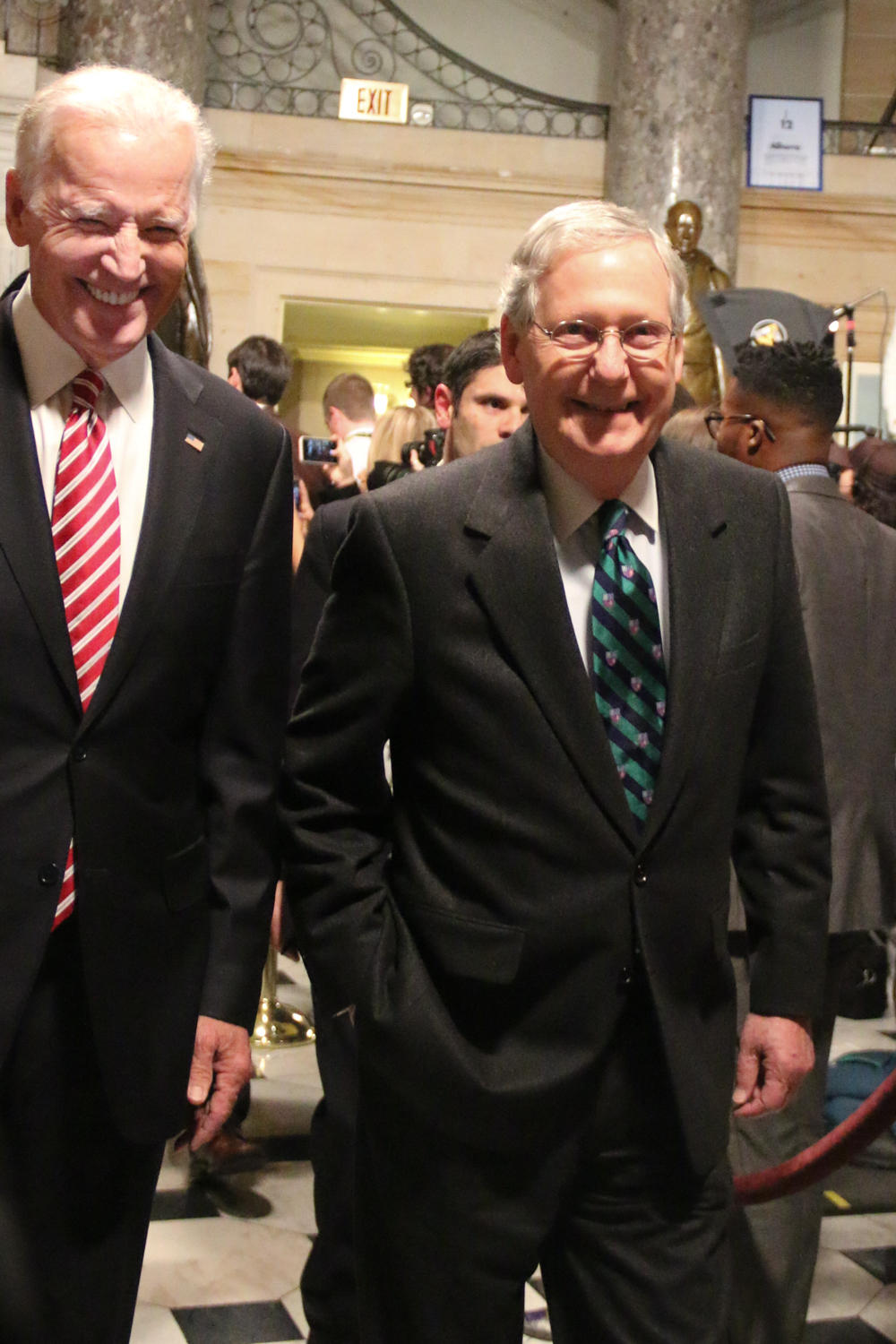 Vice President Joe Biden and Senate Majority Leader Mitch McConnell share a laugh before the State of the Union.