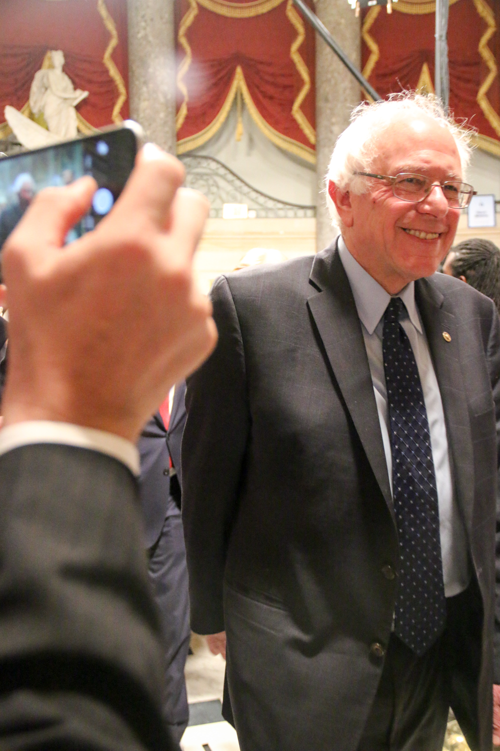 Presidential hopeful Sen. Bernie Sanders, D-Vt., walks toward the House Chamber.