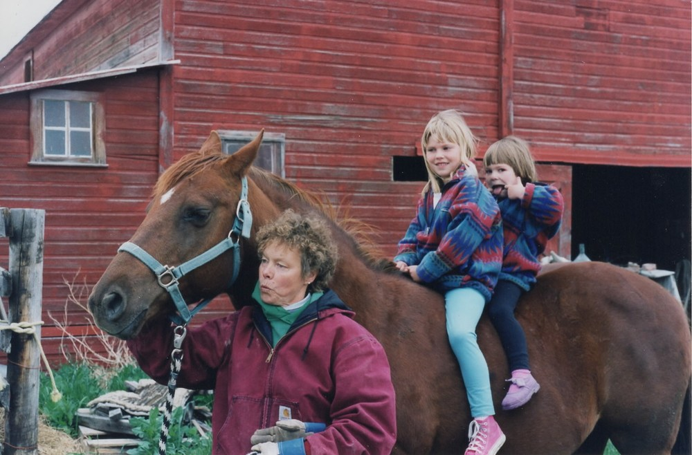 My grandma Judy takes my sister and me for a ride with Lady Red.