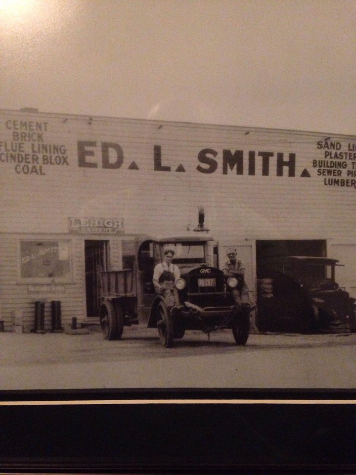 - Chris's grandfather, Bill Smith is on the left. This image is estimated to have been taken in the late 20's in front of the old building. I bet they were hyped to take this picture since getting into hardware delivery was probably a game changer for them! In the late 1940's this building was torn down that and the building you currently see was built on the same plot of land. Smith Bros Hardware has been in this same location since the beginning which resides near the hustle and bustle of main street Raytown, Mo.