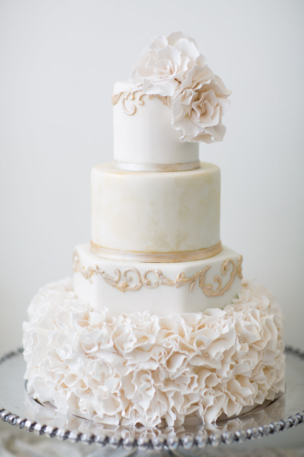 Welcome to my web site. It is my pleasure to showcase our style and  philosophy on the art of wedding cakes. From simple butter cream with  delicate flavors t