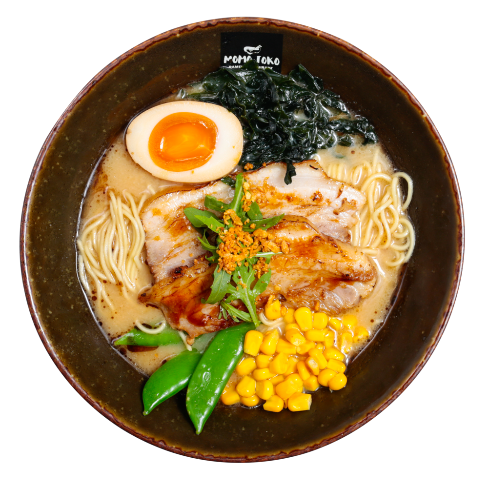 Original Tonkotsu Ramen -15,50€ - Tonkotsu Pork Broth, Ramen Noodles, Pork Belly, Soy Marinated Half Egg, Seaweed, Sugar Snap Peas, Corn, Arugula, Fried Garlic & Black Sesame Oil (G, M, S, SP)