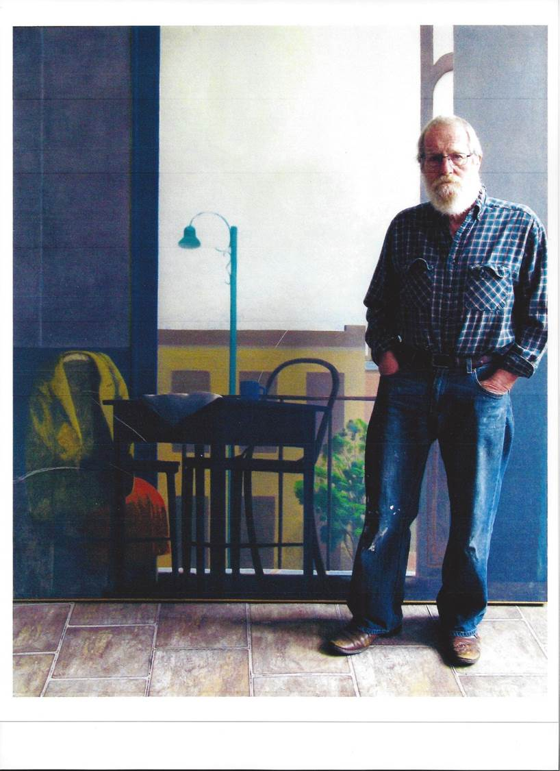 James Hennessey standing in front of a painting in his studio. Title:  Lima