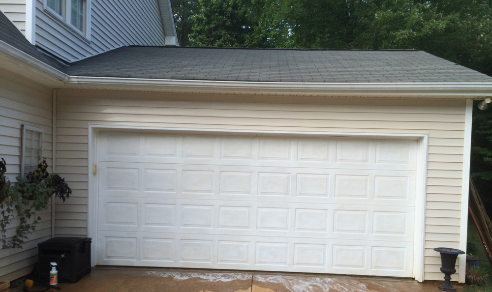 Plum prettyfaux carriage style garage doors diy for Carriage style garage doors with windows