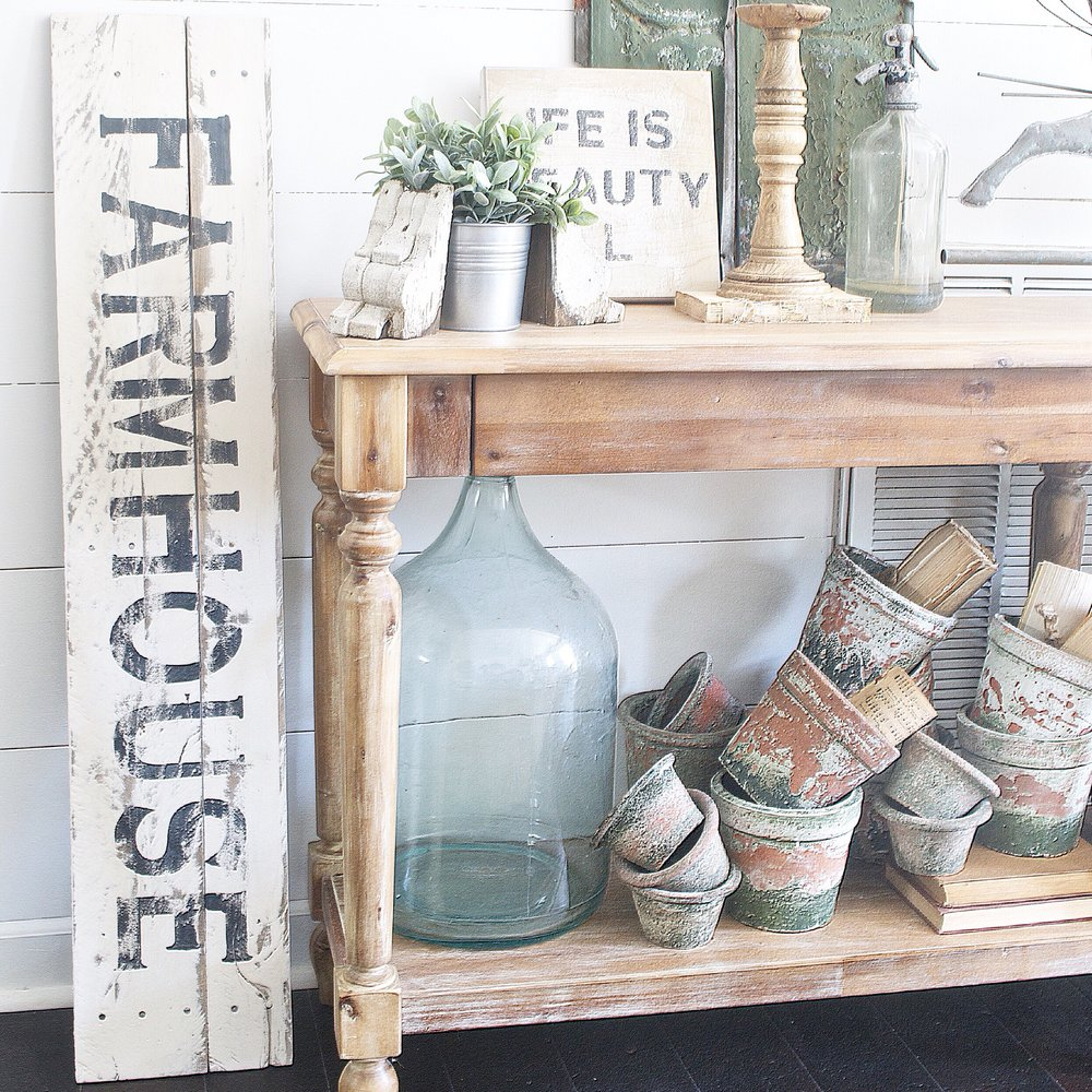 Gallery Wall with a Hand Made Farm House Sign by Plum Pretty Decor and Design