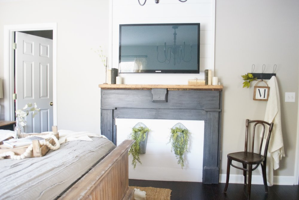Plum Pretty Decor and Design Farmhouse Master Bedroom Tour- Faux Fireplace TV Mount