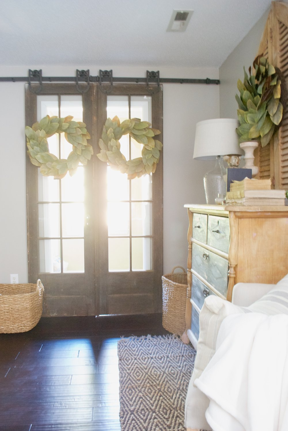 Plum Pretty Decor And Design Farmhouse Master Bedroom Tour  French Doors And  Magnolia Wreaths