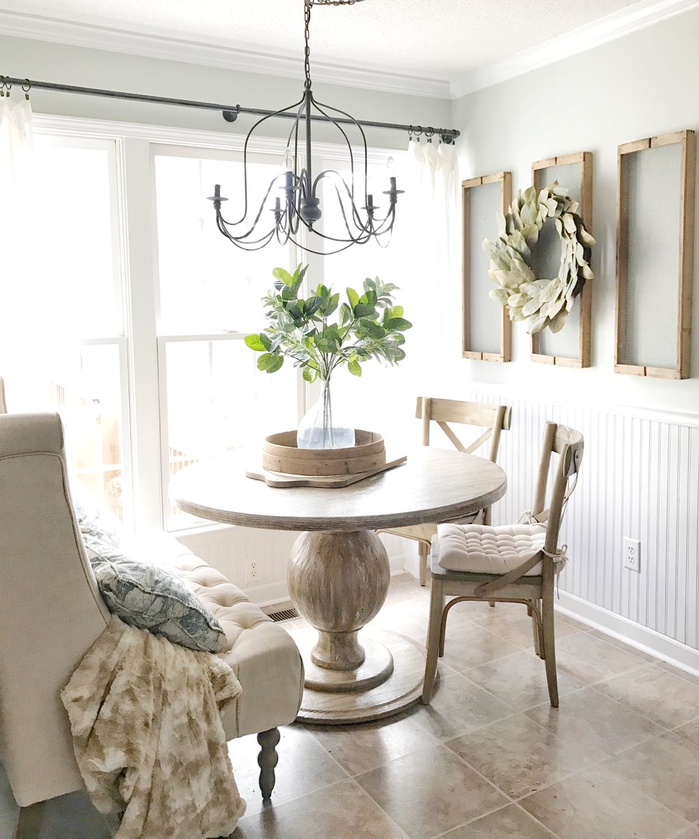 Home Tour- Farmhouse Style Breakfast Nook with Drying Rack Wall Decor, Round Dining Table, and Tufted Sofa by Plum Pretty Decor and Design