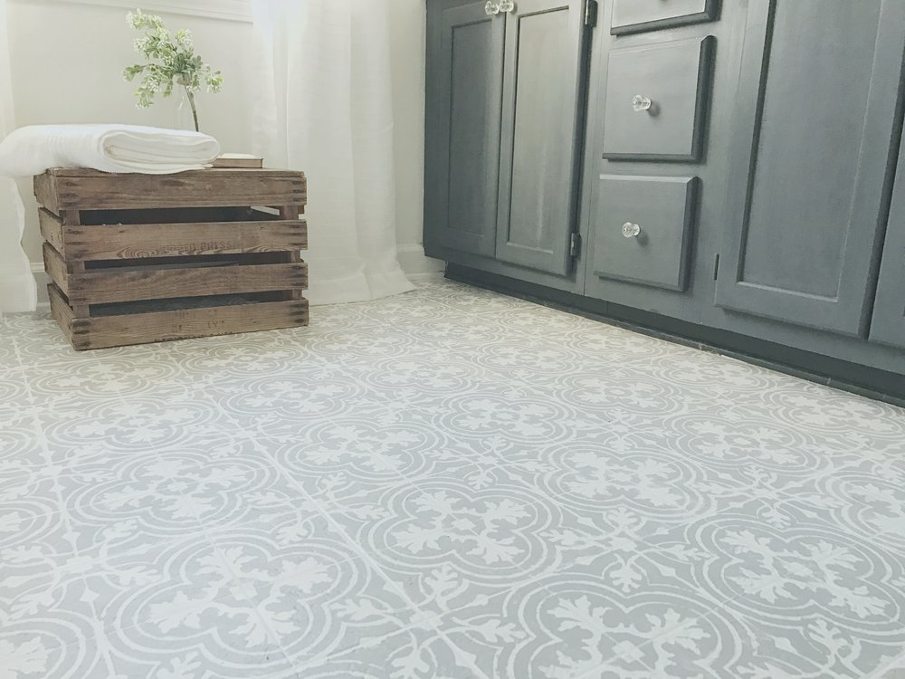 Linoleum best a diy stenciled linoleum bathroom floor for Patterned linoleum tiles