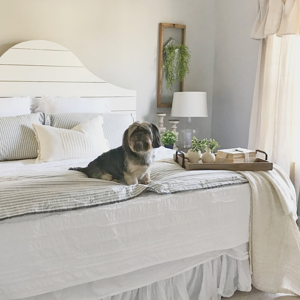 The Simple Abode's Farmhouse Style Master Bedroom- Shiplap Bed and Puppy- Interior Design by Plum Pretty Decor and Design