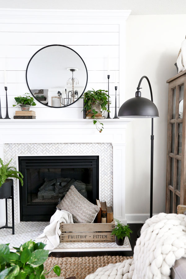 Black Swing arm lamp and a modern farmhouse fireplace. Spring Living Room Update with HomeGoods- Modern Farmhouse Living Room by Plum Pretty Decor & Design Co.