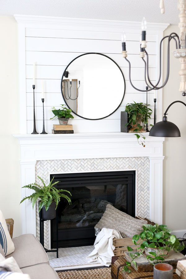 Modern Farmhouse Fireplace. A spring living room revamp with HomeGoods by Plum Pretty Decor & Design Co.