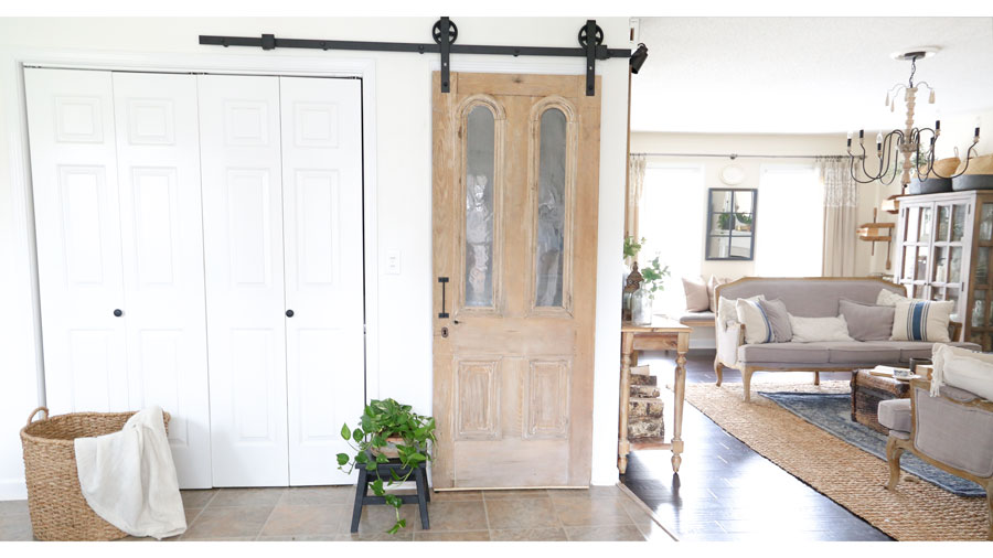 Antique Pantry Door on Sliding Barn Door Hardware. A complete tutorial on how to install sliding barn door hardware by Plum Pretty Decor & Design Co.
