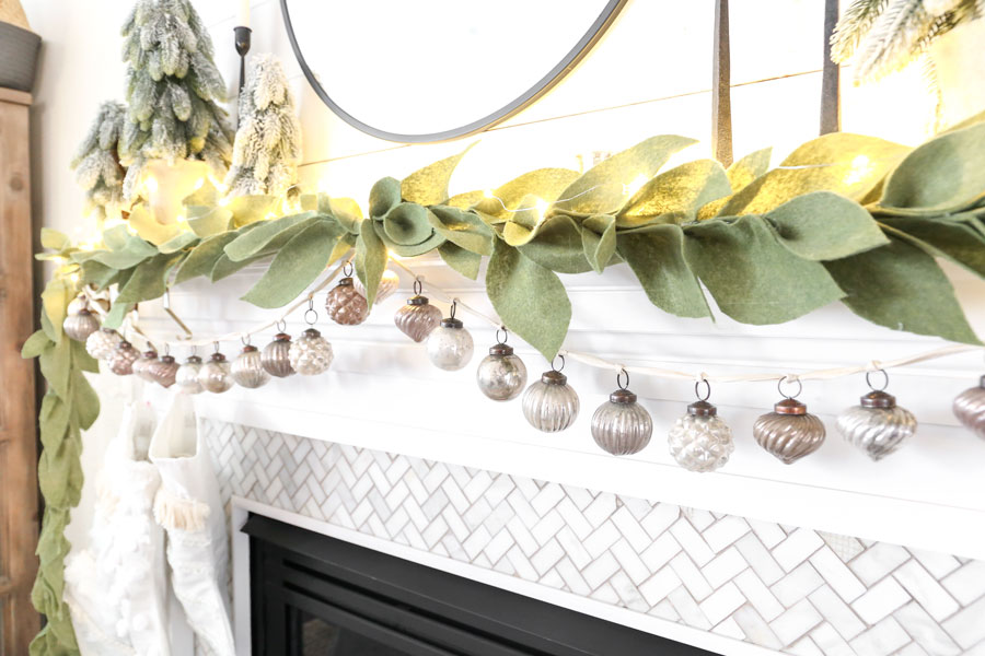 Christmas Mantel Decor with a Mercury Glass Ornament Garland - DIY felt leaf garland and textured neutral stockings. You can find the tutorial for both on Plum Pretty Decor & Design Co. blog.