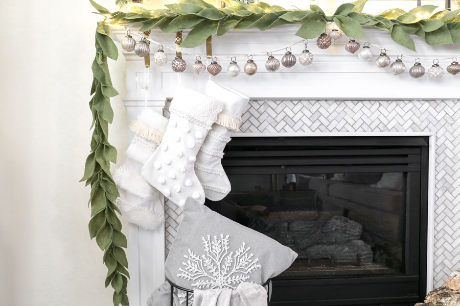 Christmas Mantel Decor- With a DIY felt leaf garland and textured neutral stockings. You can find the tutorial for both on Plum Pretty Decor & Design Co. blog.