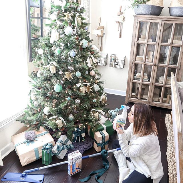 """Santa baby, slip some BONA under the tree for me. Been an awful good girl."" Today on the blog I shared my newest secret weapon for cleaning my floors by @bonafloorcare. You guys know how much I LOVE my Bona and this might be my favorite product yet! My floors haven't looked this good since we installed them.  Head over to the link in my profile and scroll down to most recent blog posts and you can read all about it there. AND see a little sneak peek of my living room Christmas tree. Now back to Birthday celebrations! Austin and the pups made me dinner and now we're all cuddled on the couch watching a movie and eating cake. ❤️ . . . #bona#bonapowerplus #bonahardwoodfloors#lovemybonafloors#cleaningtips#cleaninghacks#darkhardwood#darkhardwoodfloors#bhghome#bhgstyle#flooring#fixerupperstyle#cottagestyle#farmhousestyle#christmastree#christmasdecor#christmascleaning#neutralchristmastree#neutralchristmas#cozychristmas"