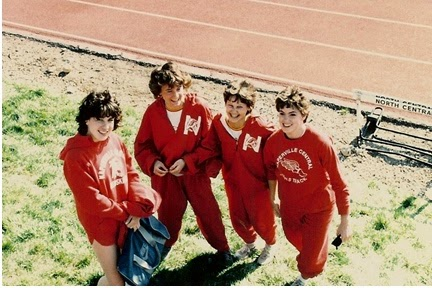 Amy with her 4x800 team in High School (we are NOT going to tell you the year).