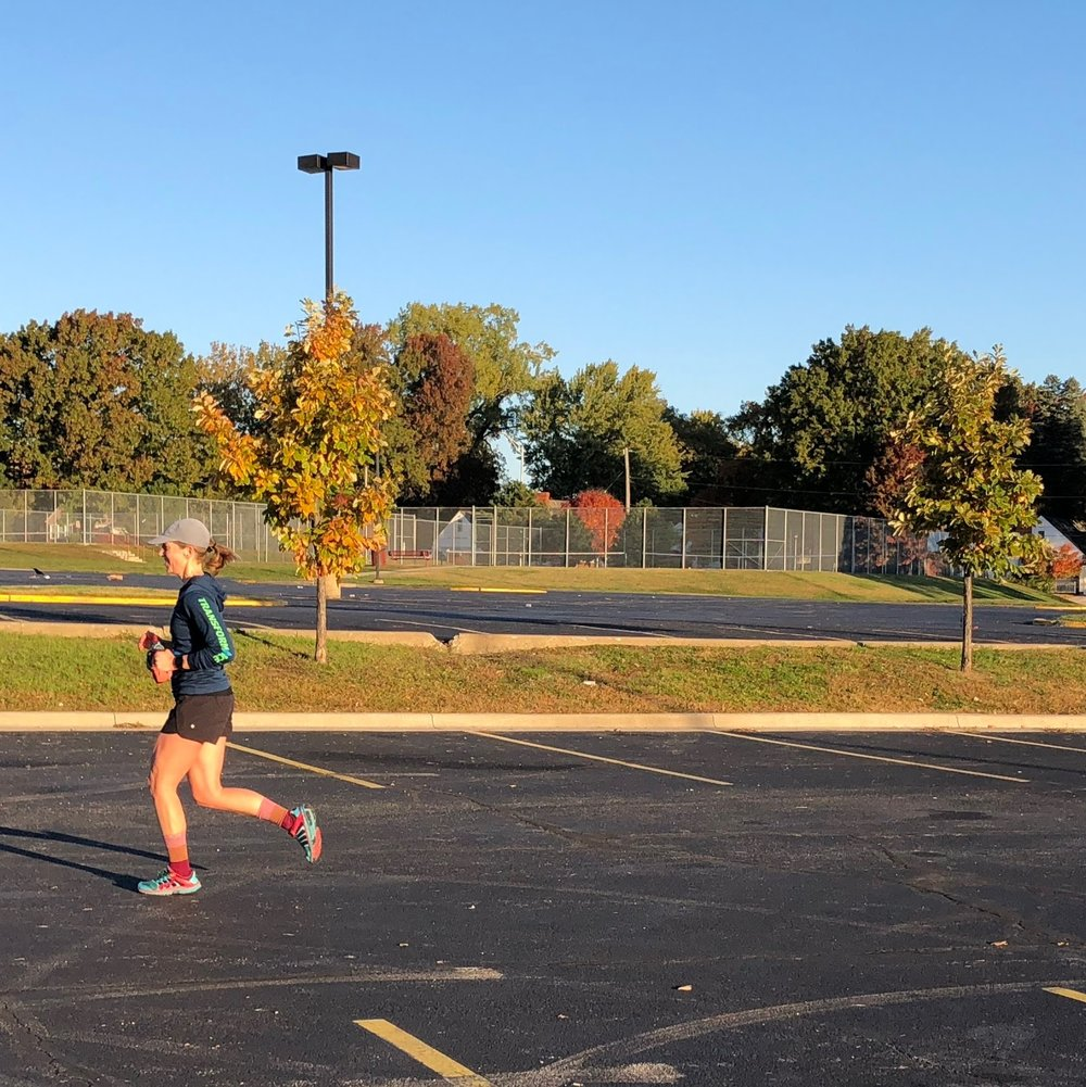 Jen K running into home base on a crisp, cool Fall morning with RRKC.