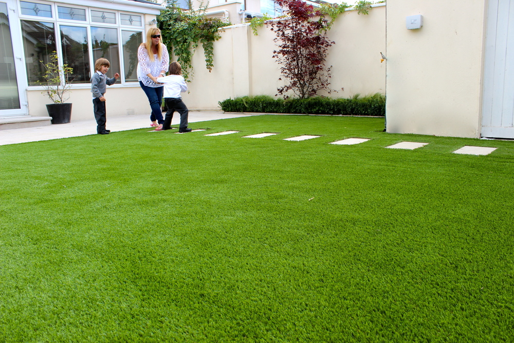 kid and mam playing on Turf