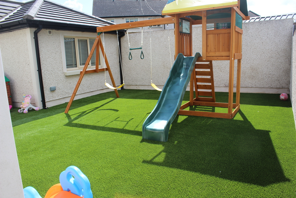 Jungle gym Playground and TigerTurf artificial Grass.JPG