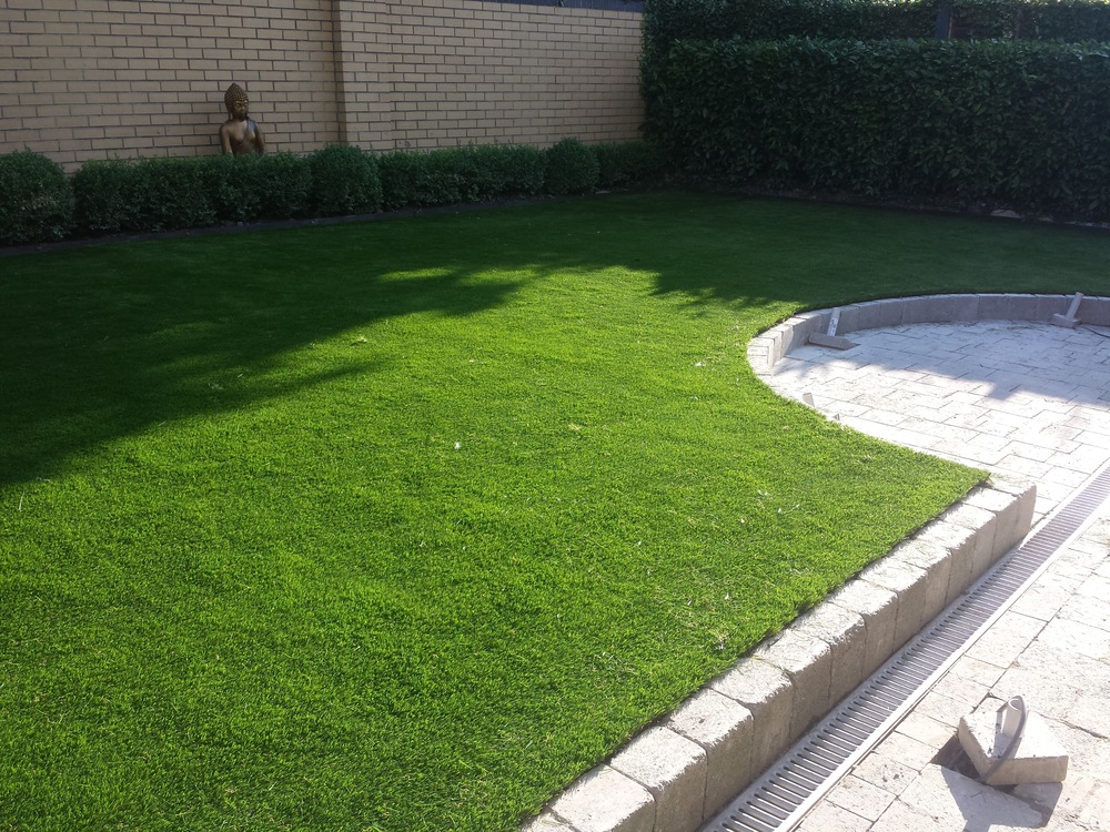 Curved paving and Grass