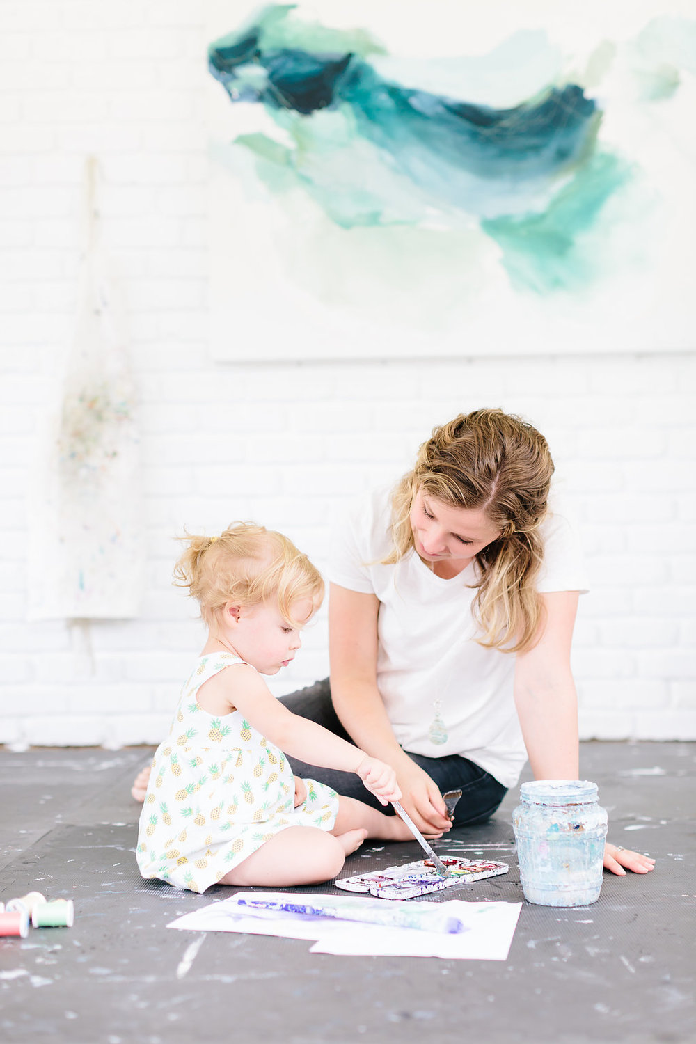 Artist and daughter in the art studio