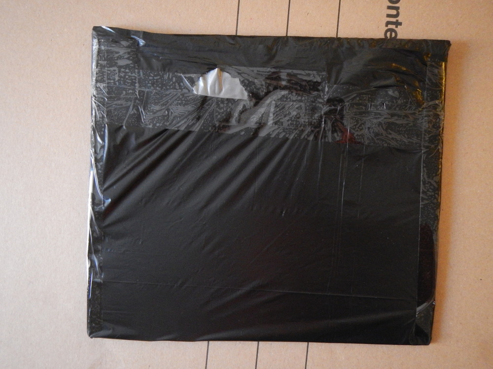 The first panel, covered and sealed with a trash bag and tape!
