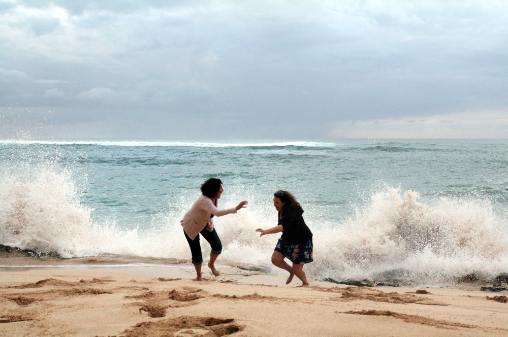 lacy and leigh chased by waves