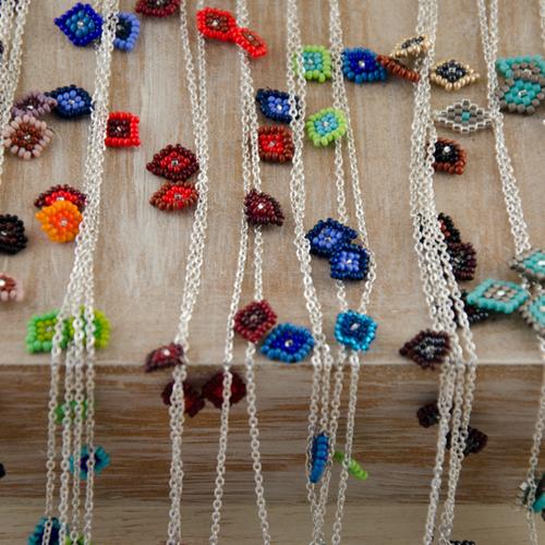 Collar MUCHOS OJITOS $ 1,200 pesos