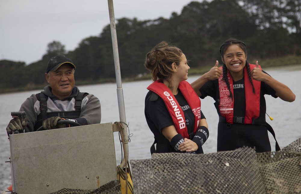 The Papa Taiao Kaitaia Academy focusses on Moana Restoration. Students are involved in establishing a small oyster farm in conjunction with Pacific Marine Fisheries in the Parengarenga Harbour. The proceeds from the sale of their oysters will be returned to Kaitaia youth involved in environmental restoration.  Tauira (students) from the Papa Taiao Kaitaia Academy are involved several sustainability projects including producing a Marine Conservation and Education aquarium for schools and kura. The MoanaRestoration students are working with the five Iwi forum in the Far North and MPI to use customary fishing rights to re-establish lost Kutai (mussel) beds on the East Coast.  Papa Taiao Kaitaia offers students the opportunity to gain NCEA qualifications in aquaculture, business studies, sustainability and biology.