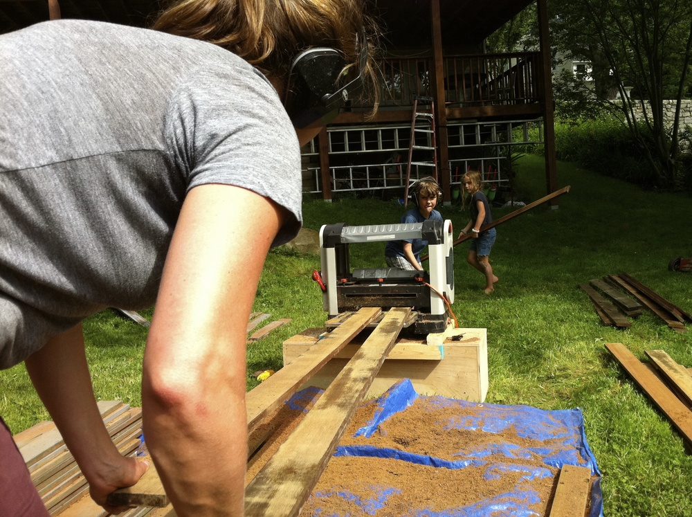 Meg, Cole and Olive plaining down old mahogany decking to reuse as siding on the shed. It took 5 days and we burned out the motor in the plainer.