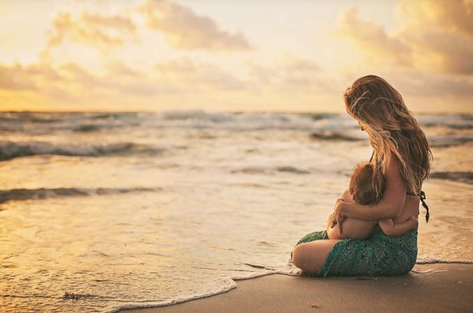 Mother breastfeeding in Hawaii by Sophia Costa