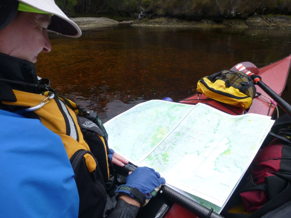 Checking our route - waterproof paper on our SW Tasmania adventure