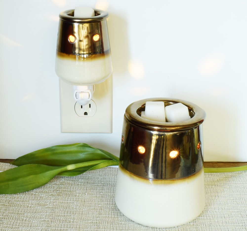 Warmers& Wax Melts - Tuscany Warmers are made to honor timeless style and modern design. Make a statement with these bold warmers and add amazing fragrance to your space with our color coordinated wax melts.