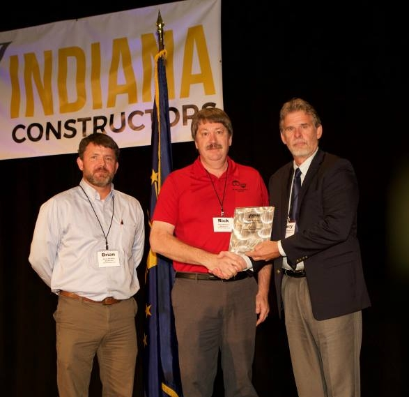 Brian Thomas - WB•K Safety Director, and Rick Niehaus – WB•K Vice President are shown accepting the 2016 Silver Safety Program Award from ICI Chairman Terry L. Morgan, Sr., President of HIS Constructors, Inc.