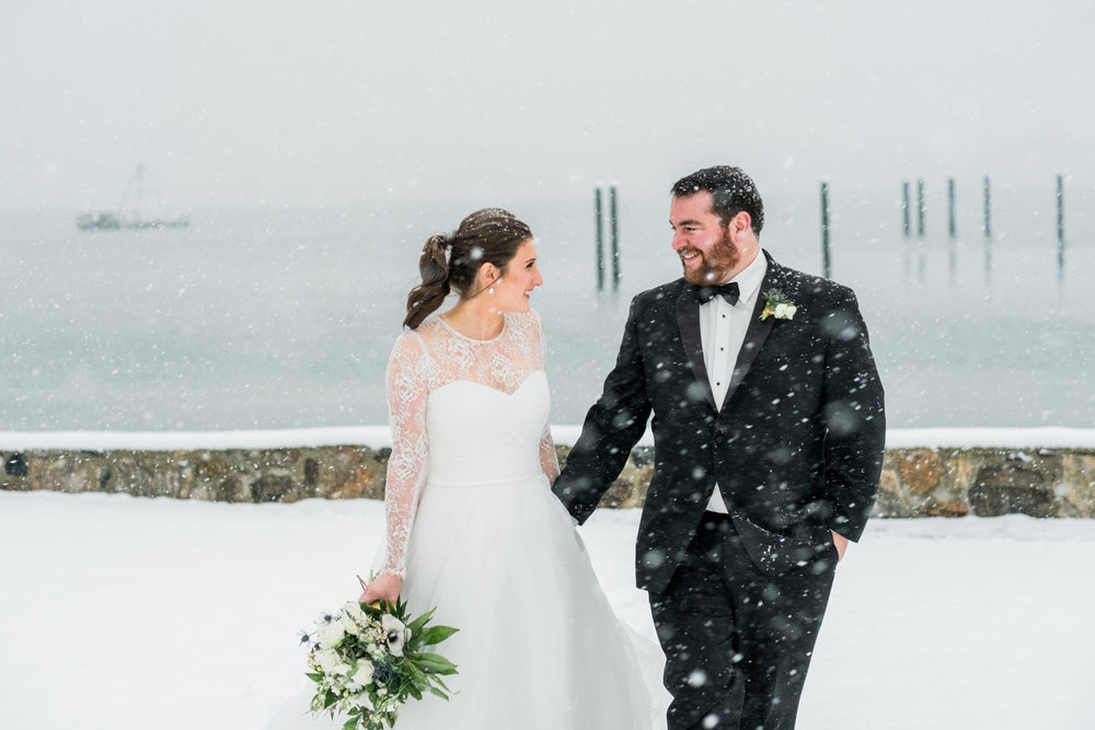 Honorable Mention 1 |Casey & Matt | Stamford Yacht Club  Fuji XT2 | 56 f1.2  Casey, Matt, and their wedding party stood out in a blizzard with me for half an hour to get photos like this one. When you plan a December wedding in New England you can end up with days like these. Crazy, beautiful, perfect days.