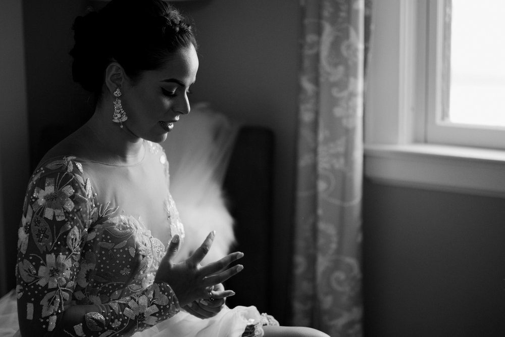 Top of 17 | Number 10 |Gina & Joe | The Pavilion on Crystal Lake  Fuji XT2 | Leica Sumilux 50 f1.4  It's tradition for the bride to switch her engagement ring from her left hand to her right shortly before the ceremony. It's usually a quick moment and not always something I catch. This simple, anxious, nervous gesture is one of the last things Gina did before she walked down the aisle to see Joe. One of my favorite frames from 2017.