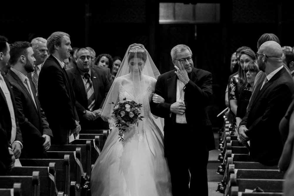 Top of 17 | Number 2  | Kate & Neil |  Battell Chapel  Fuji XT2 | Leica Sumilux 50 f1.4  There were seven photos that made my initial cut from Kate and Neil's wedding that I considered for this list, but none of the other six came close to this one. There's a lot to like about this photo; Kate's dress, specifically her traditional veil, the little lanterns lining the pews... the fact that not one person has their phone out (which I haven't seen in 300+ weddings in my career). Beyond all that is the pure and simple expression of joy coming from her father. There are few traditions left in wedding photography that can be this powerful - and the one I love to photograph most is when the bride comes down the aisle in front of all of her family and friends.