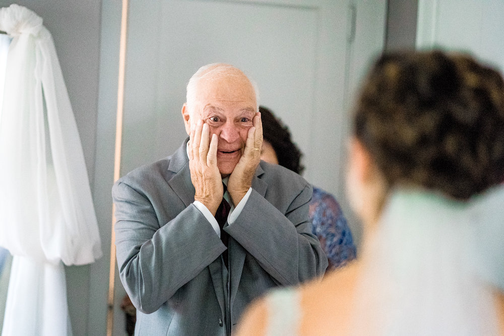 2018 Number 6 | Stephanie & Mike | The Pavilion on Crystal Lake  Sony a9 | 50 f1.8  Whenever possible I love to photograph the reaction of a bride's father when he gets to see her for the first time. As a father with a daughter, I can't even begin to comprehend the enormity of this moment. An easy pick for 2018.
