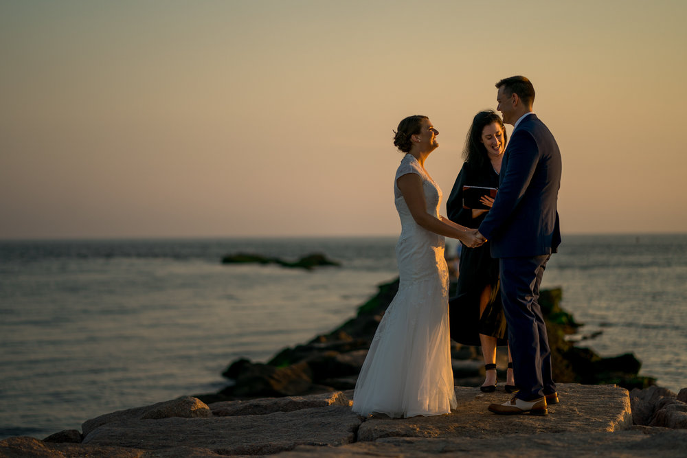 2018 Number 4 | Cassie & Chris | Hammonasset Beach  Sony a9 | 85 f1.8  I've shot a lot of weddings for friends and family over the years. When Corey's sister Cassie and her husband Chris got engaged I hoped they would ask me to photograph their wedding. Cassie and Chris had a quiet, personal, and emotional ceremony on the rocks of Hammonasset Beach. It was a cool, still July night. A few beachgoers looked on as the JP from my own wedding married the two of them just as the sun dipped below the horizon. It was a real pleasure to photograph their ceremony. It was one of the more memorable moments of my career.