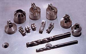 The above photo illustrates the wide variety of tooling that requires edge prep in today's demanding manufacturing environments.