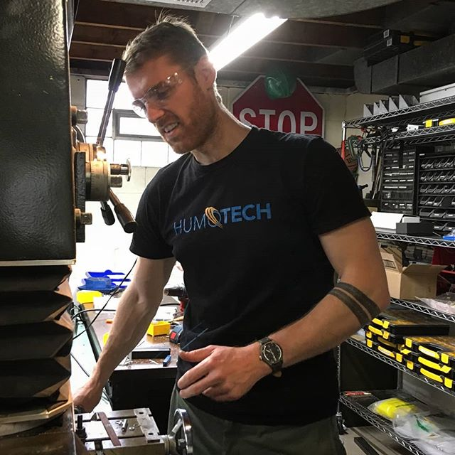 ☆☆ T-SHIRT GIVEAWAY ☆☆ Send us a message or email (info@humotech.com) with your name, address, and a sentance or two about what #Humotech means to you and we'll send you a t-shirt. While supplies last.  Here's Blair sporting our stylish tee while making parts for a #prototype #exoskeleton. #madeinusa #safetyfirst #prosthetics #robotics