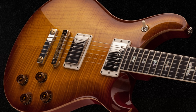 The PRS Vela tosses together one single coil foil pickup with a traditional humbucker to make a flexible guitar that sounds any way you want it to. Now... it's up to you...