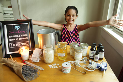 Here I am showing off the supplies needed to make candles! Curious Kathryn makes them special with love and magic! :)