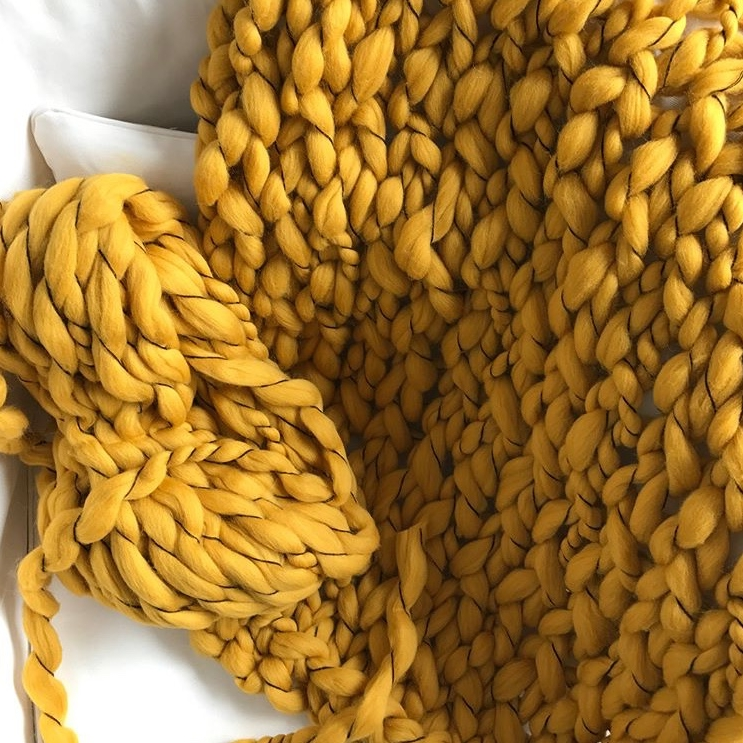 Make your own cozy knit blanket at Studio How-To . Photo credit: Studio How-To's Instagram