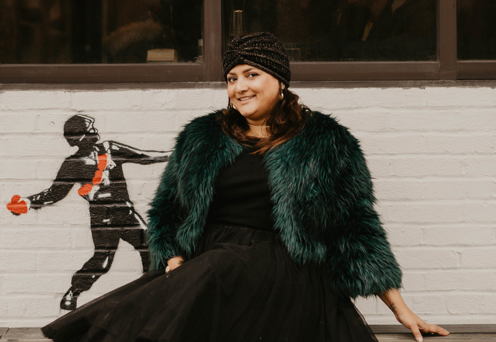 Styling our  wide hoop earrings  with a tulle skirt, black tee, faux fur jacket and turban. Also pictured, Capsule ONE  thin choker necklace