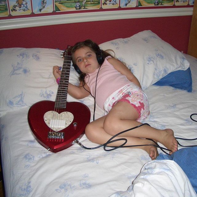 well it's certainly been a crazy week of adulting. big thanks for listening and sharing the new ep :') these tunes mean a lot to me and I'm thankful they're finally out. learned a whole freakin' lot during this process and still learning. cheers to growing up - it's awkward.  here's a relic of tiny tot me posing with my dream guitar, which I was forced to trade for a baby strat when my guitar teacher refused to teach me on this thing. RIP daisy heart guitar.