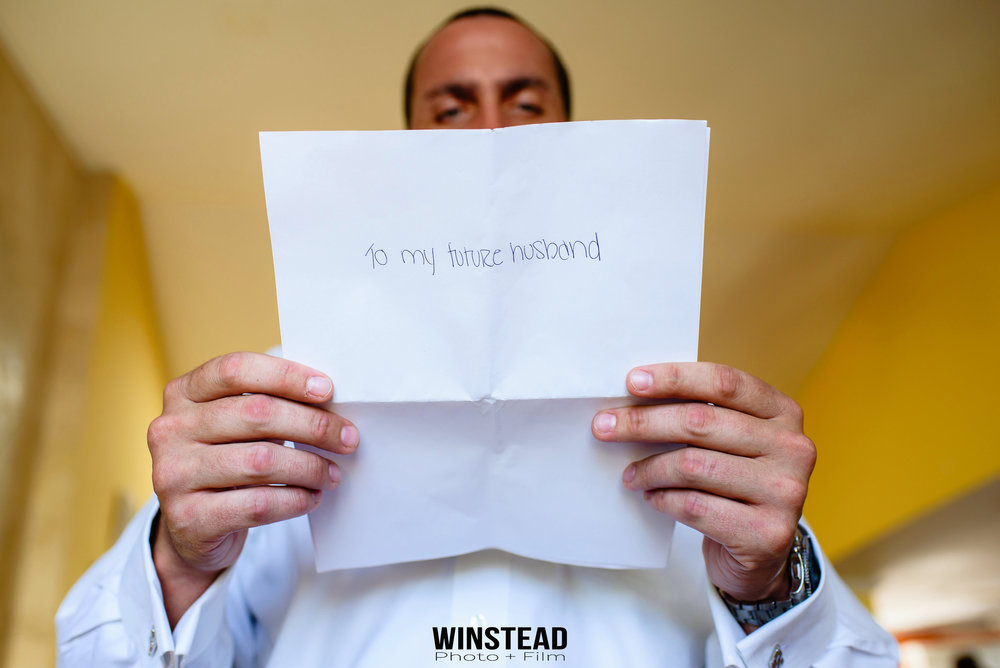 groom-letter-reading-wedding-nc-photographer.jpg